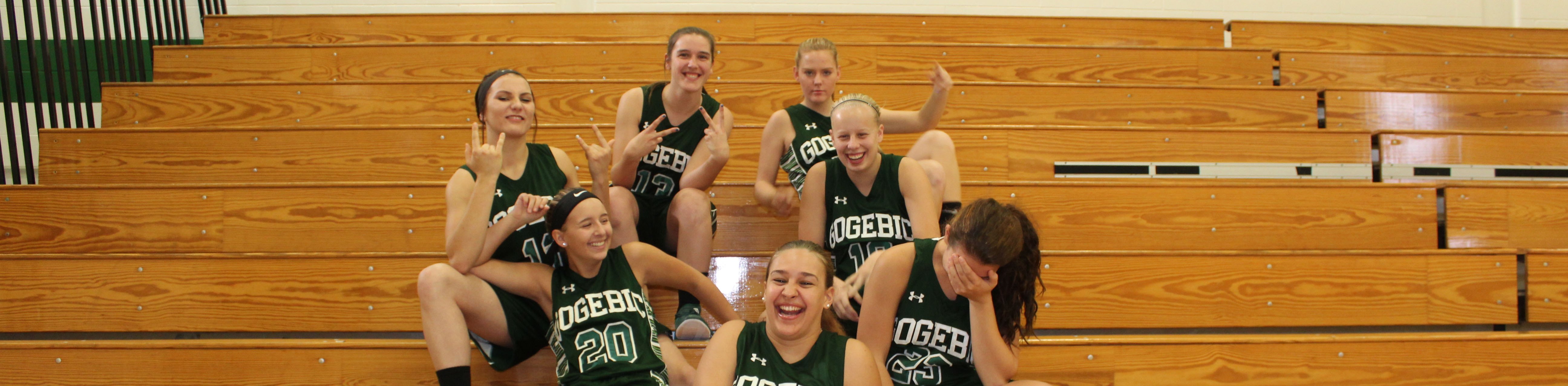 Girls basketball team having fun.