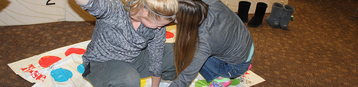 Image of students having a good time at Twister